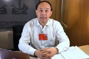 周洪宇代表主张施行残疾学生15年免费教育